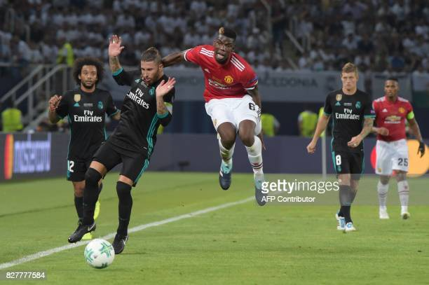 Manchester United's French midfielder Paul Pogba vies with Real Madrid's Spanish defender Sergio Ramos during the UEFA Super Cup football match...