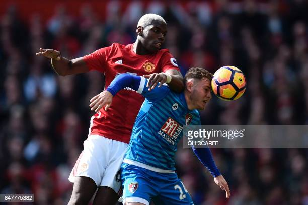 TOPSHOT Manchester United's French midfielder Paul Pogba vies with Bournemouth's Scottish midfielder Ryan Fraser during the English Premier League...