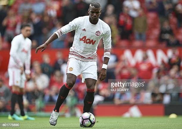 Manchester United's French midfielder Paul Pogba warms up ahead of the English Premier League football match between Manchester United and Manchester...
