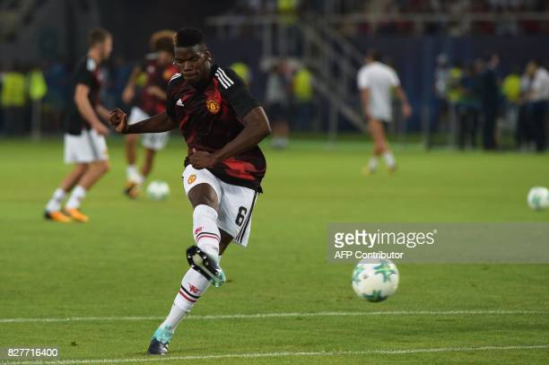 Manchester United's French midfielder Paul Pogba warms up prior to the UEFA Super Cup football match between Real Madrid and Manchester United on...