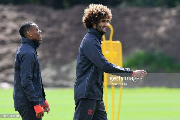 Manchester United's French striker Anthony Martial and Manchester United's Belgian midfielder Marouane Fellaini attend a team training session at the...