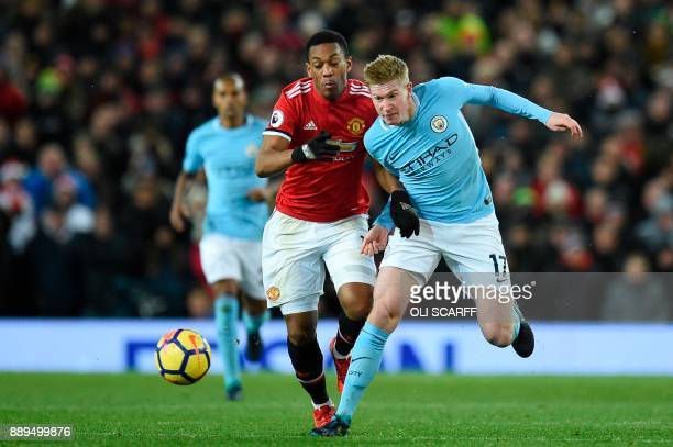 Manchester United's French striker Anthony Martial and Manchester City's Belgian midfielder Kevin De Bruyne chase the ball during the English Premier...