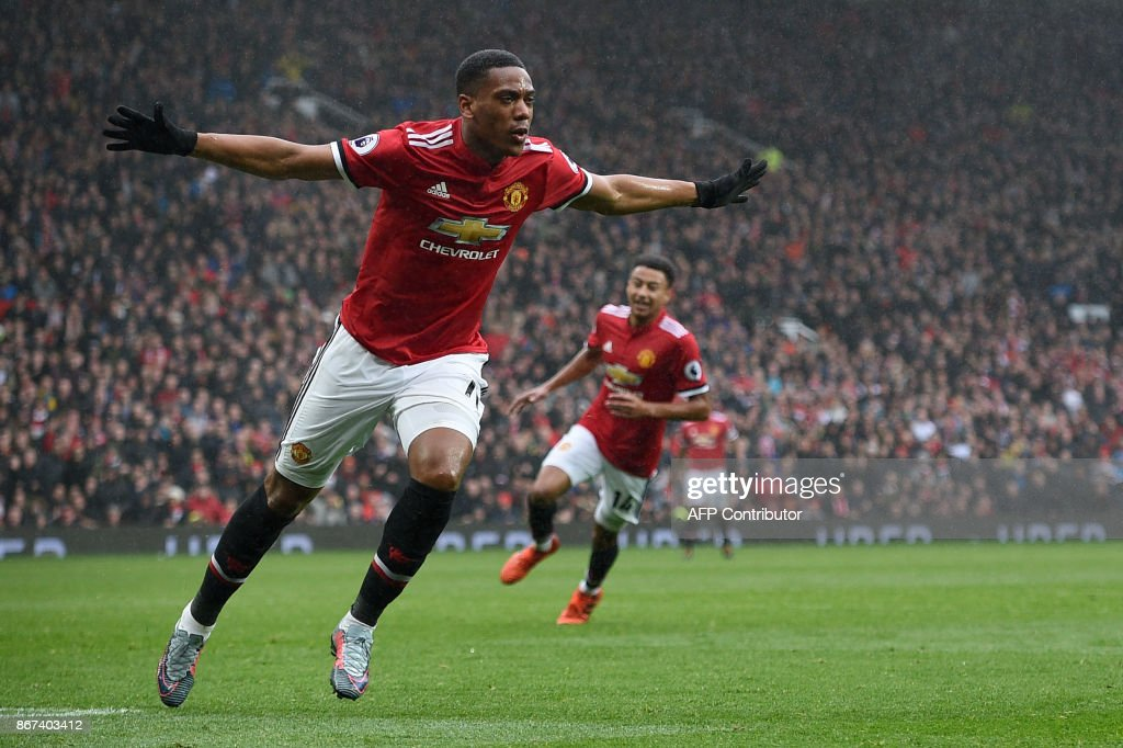 Manchester United's French striker Anthony Martial celebrates after scoring the opening goal of the English Premier League football match between Manchester United and Tottenham Hotspur at Old Trafford in Manchester, north west England, on October 28, 2017. / AFP PHOTO / Oli SCARFF / RESTRICTED TO EDITORIAL USE. No use with unauthorized audio, video, data, fixture lists, club/league logos or 'live' services. Online in-match use limited to 75 images, no video emulation. No use in betting, games or single club/league/player publications. /