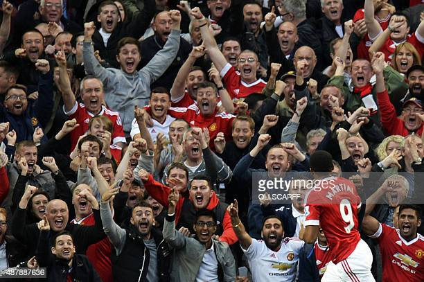 Manchester United's French striker Anthony Martial celebrates scoring their third goal during the English Premier League football match between...