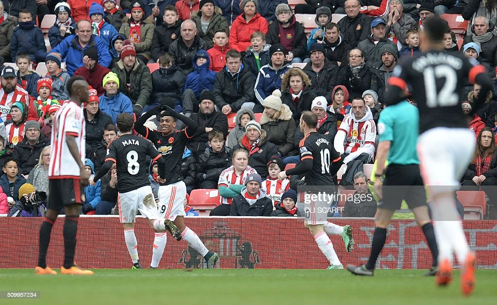 Manchester United's French striker Anthony Martial (3L) celebrates scoring his team's first goal during the English Premier League football match between Sunderland and Manchester United at the Stadium of Light in Sunderland, northeast England on February 13, 2016. / AFP / OLI SCARFF / RESTRICTED TO EDITORIAL USE. No use with unauthorized audio, video, data, fixture lists, club/league logos or 'live' services. Online in-match use limited to 75 images, no video emulation. No use in betting, games or single club/league/player publications. /