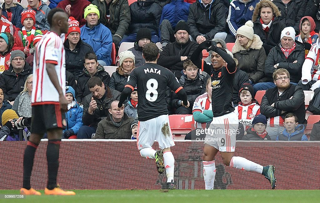 Manchester United's French striker Anthony Martial (R) celebrates scoring his team's first goal during the English Premier League football match between Sunderland and Manchester United at the Stadium of Light in Sunderland, northeast England on February 13, 2016. / AFP / OLI SCARFF / RESTRICTED TO EDITORIAL USE. No use with unauthorized audio, video, data, fixture lists, club/league logos or 'live' services. Online in-match use limited to 75 images, no video emulation. No use in betting, games or single club/league/player publications. /