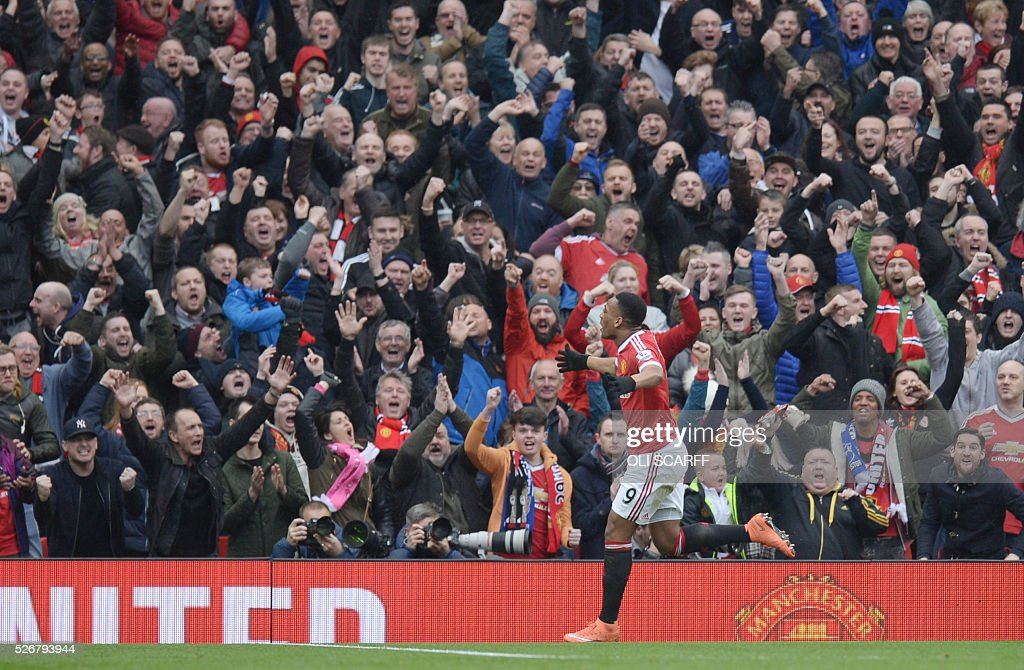 Manchester United's French striker Anthony Martial celebrates scoring the opening goal during the English Premier League football match between Manchester United and Leicester City at Old Trafford in Manchester, north west England, on May 1, 2016. / AFP / OLI SCARFF / RESTRICTED TO EDITORIAL USE. No use with unauthorized audio, video, data, fixture lists, club/league logos or 'live' services. Online in-match use limited to 75 images, no video emulation. No use in betting, games or single club/league/player publications. /