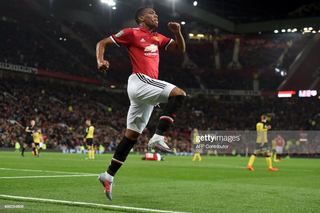 Manchester United's French striker Anthony Martial celebrates scoring his team's fourth goal during the English League Cup third round football match between Manchester United and Burton Albion at Old Trafford in Manchester on September 20, 2017. / AFP PHOTO / PAUL ELLIS / RESTRICTED TO EDITORIAL USE. No use with unauthorized audio, video, data, fixture lists, club/league logos or 'live' services. Online in-match use limited to 75 images, no video emulation. No use in betting, games or single club/league/player publications. /