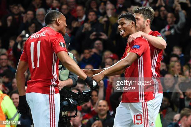 Manchester United's French striker Anthony Martial celebrates with Manchester United's English striker Marcus Rashford and Manchester United's...