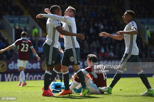 Manchester United's French striker Anthony Martial celebrates with Manchester United's English striker Wayne Rooney after scoring during the English...