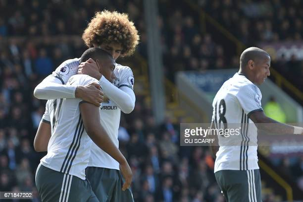 Manchester United's French striker Anthony Martial celebrates with Manchester United's Belgian midfielder Marouane Fellaini after scoring during the...
