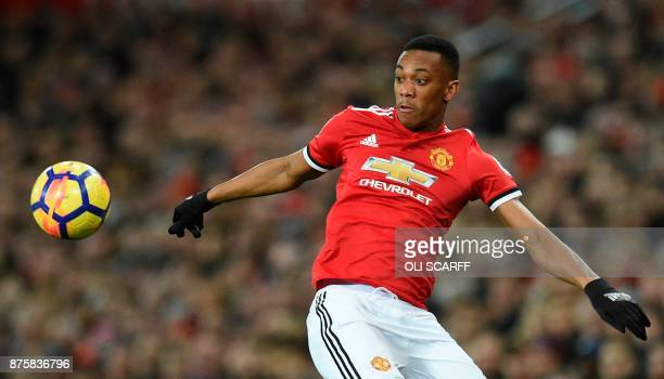 Manchester United's French striker Anthony Martial controls the ball during the English Premier League football match between Manchester United and...