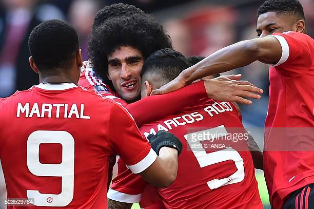 Manchester United's French striker Anthony Martial Manchester United's Argentinian defender Marcos Rojo and Manchester United's English striker...
