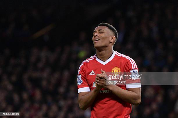 Manchester United's French striker Anthony Martial reacts after a missed chance during the English Premier League football match between Manchester...