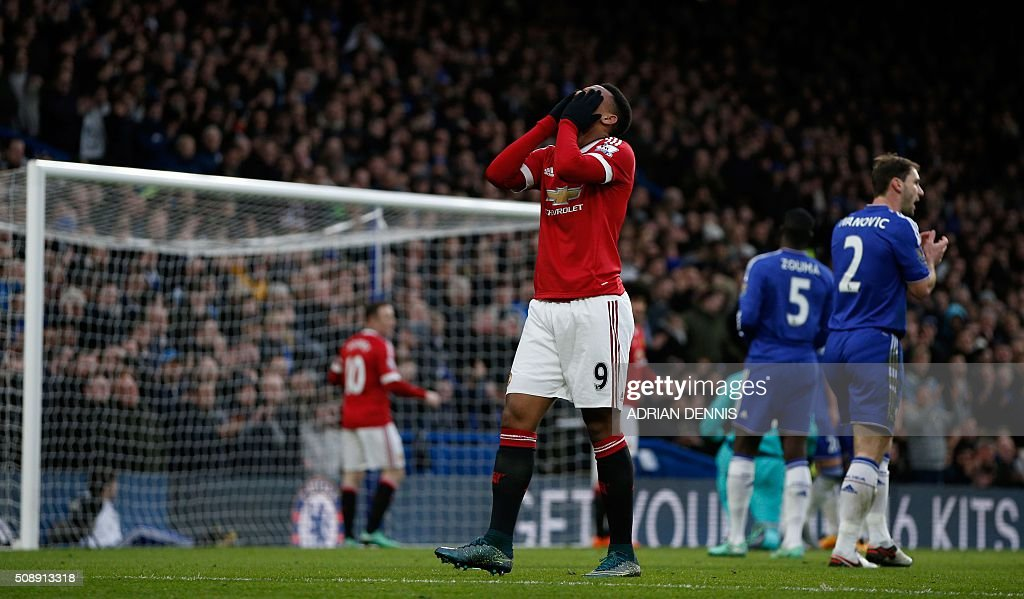 Manchester United's French striker Anthony Martial reacts after missing a goal scoring opportunity during the English Premier League football match between Chelsea and Manchester United at Stamford Bridge in London on February 7, 2016. / AFP / ADRIAN DENNIS / RESTRICTED TO EDITORIAL USE. No use with unauthorized audio, video, data, fixture lists, club/league logos or 'live' services. Online in-match use limited to 75 images, no video emulation. No use in betting, games or single club/league/player publications. /