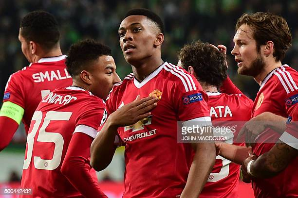 Manchester United's French striker Anthony Martial reacts after scoring the opening goal during the UEFA Champions League Group B secondleg football...
