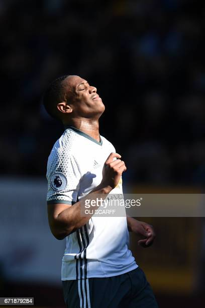 Manchester United's French striker Anthony Martial reacts during the English Premier League football match between Burnley and Manchester United at...