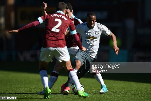 Manchester United's French striker Anthony Martial runs with the ball during the English Premier League football match between Burnley and Manchester...