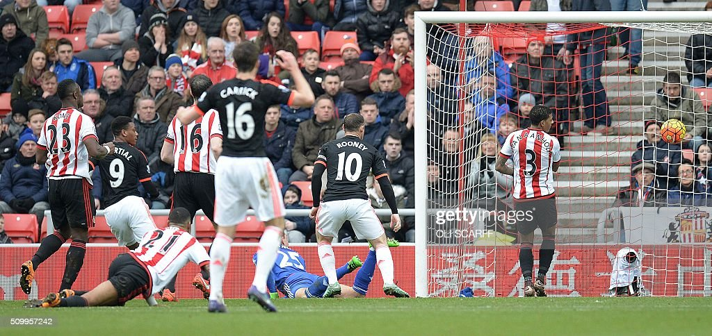 Manchester United's French striker Anthony Martial (2L) scores his team's first goal during the English Premier League football match between Sunderland and Manchester United at the Stadium of Light in Sunderland, northeast England on February 13, 2016. / AFP / OLI SCARFF / RESTRICTED TO EDITORIAL USE. No use with unauthorized audio, video, data, fixture lists, club/league logos or 'live' services. Online in-match use limited to 75 images, no video emulation. No use in betting, games or single club/league/player publications. /