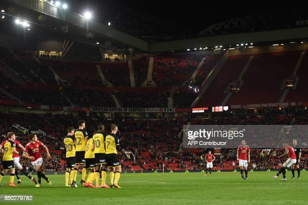 Manchester United's French striker Anthony Martial takes a free kick during the English League Cup third round football match between Manchester...