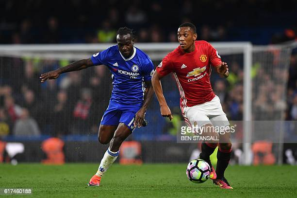 Manchester United's French striker Anthony Martial takes on Chelsea's Nigerian midfielder Victor Moses during the English Premier League football...