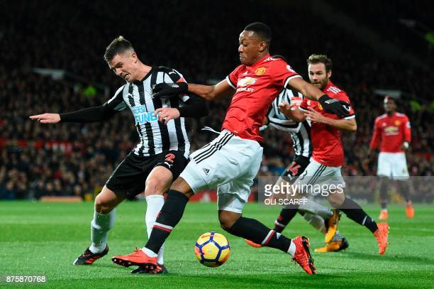 Manchester United's French striker Anthony Martial takes on Newcastle United's Irish defender Ciaran Clark during the English Premier League football...