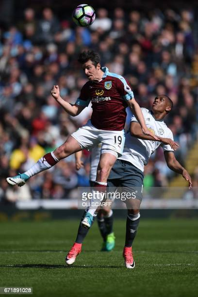 Manchester United's French striker Anthony Martial vies for the ball with Burnley's English midfielder Joey Barton during the English Premier League...