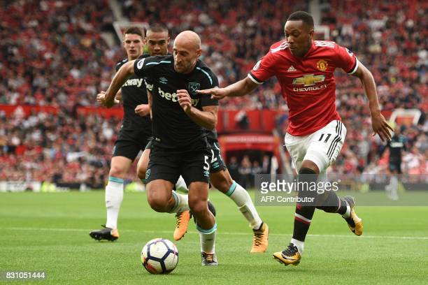 Manchester United's French striker Anthony Martial vies with West Ham United's Argentinian defender Pablo Zabaleta during the English Premier League...