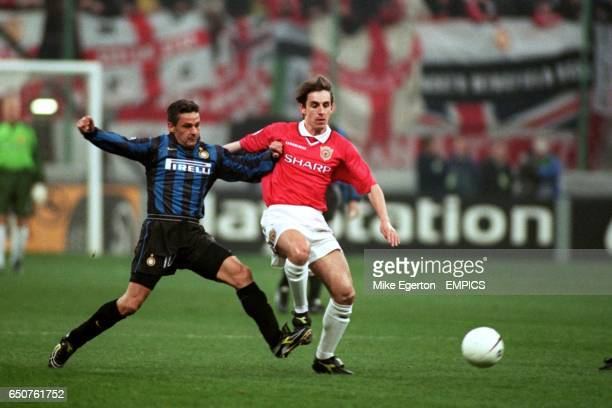 Manchester United's Gary Neville and Inter's Roberto Baggio challenge for tha ball