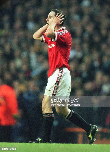 FEATURE Manchester United's Gary Neville covers his ears as he walks to the tunnel following his second bookable offence during today's December 12...