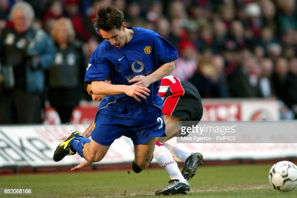 Manchester United's Gary Neville falls to the floor following a challenge from Southampton's Francis Benali