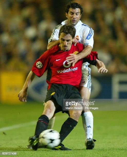 Manchester United's Gary Neville is challenged by Real Madrid's Luis Figo during their Champions League quarterfinal first leg match at the Santiago...