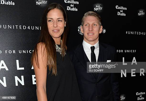 Manchester United's German midfielder Bastian Schweinsteiger and his girlfriend tennis player Ana Ivanovic pose for pictures on the red carpet as...