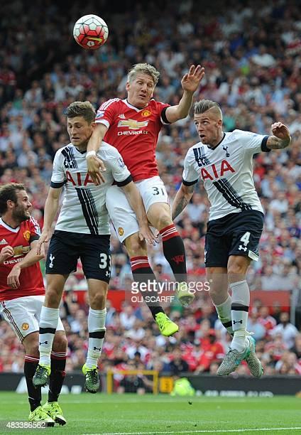 Manchester United's German midfielder Bastian Schweinsteiger vies with Tottenham Hotspur's Welsh defender Ben Davies and Tottenham Hotspur's Belgian...