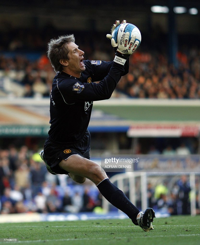 Manchester United's goalkeeper Edwin Van der Sar grimaces as he makes a save against Birmingham City during the Premiership football match at St...