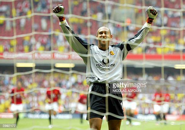 Manchester United's goalkeeper Tim Howard celebrates blocking Arsenal's Robert Pires' penalty kick to give his team the win during the FA Community...