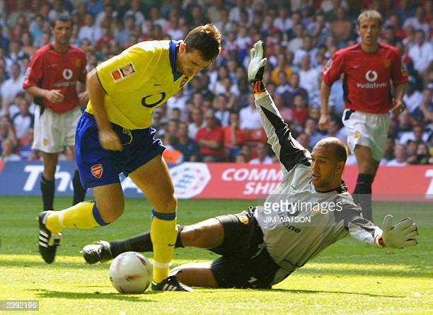 Manchester United's goalkeeper Tim Howard stops an attempted shot by Arsenal's Francis Jeffers during the FA Community Shield soccer match at the...