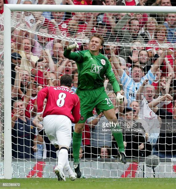Manchester United's goalkeeper Tomasz Kuszczak celebrates after saving a penalty from Arsenal's Gilberto Silva during during the Barclays Premiership...