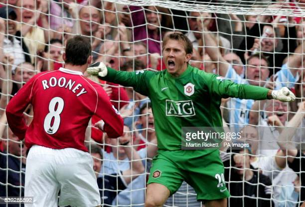 Manchester United's goalkeeper Tomasz Kuszczak celebrates saving a penalty from Arsenal's Gilberto Silva during the Barclays Premiership match at Old...