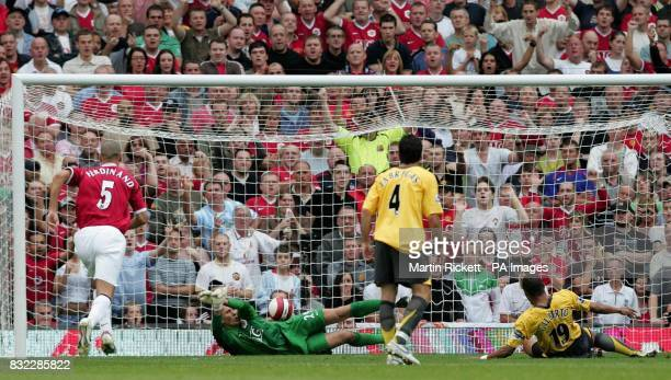 Manchester United's goalkeeper Tomasz Kuszczak saves a penalty from Arsenal's Gilberto Silvaduring the Barclays Premiership match at Old Trafford...