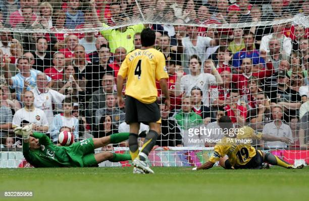 Manchester United's goalkeeper Tomasz Kuszczak saves a penalty from Arsenal's Gilberto Silva during the Barclays Premiership match at Old Trafford...