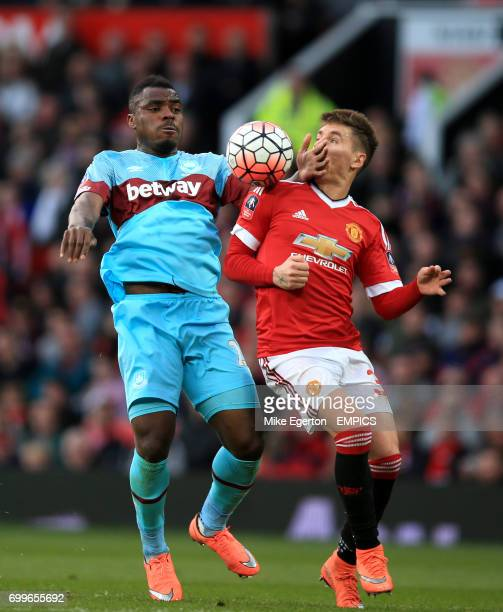 Manchester United's Gullermo Varela and West Ham United's Emmanuel Emenike battle for the ball