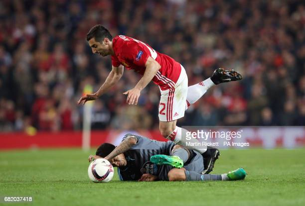 Manchester United's Henrikh Mkhitaryan and Celta Vigo's Pablo Hernandez battle for the ball during the UEFA Europa League Second Leg match at Old...