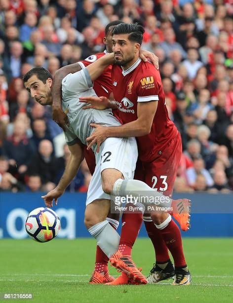 Manchester United's Henrikh Mkhitaryan and Liverpool's Emre Can battle for the ball during the Premier League match at Anfield Liverpool