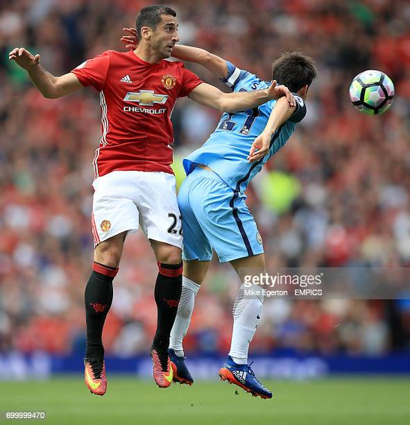 Manchester United's Henrikh Mkhitaryan and Manchester City's David Silva battle for the ball in the air