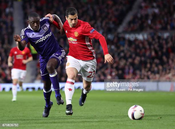 Manchester United's Henrikh Mkhitaryan and RSC Anderlecht's Dennis Appiah battle for the ball during the UEFA Europa League Quarter Final match at...
