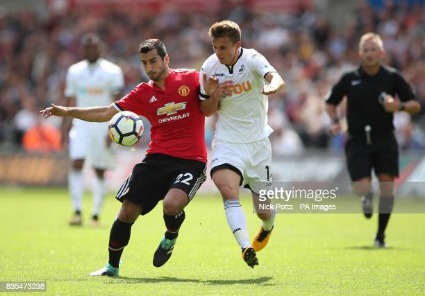 Manchester United's Henrikh Mkhitaryan and Swansea City's Tom Carroll battle for the ball during the Premier League match at the Liberty Stadium...