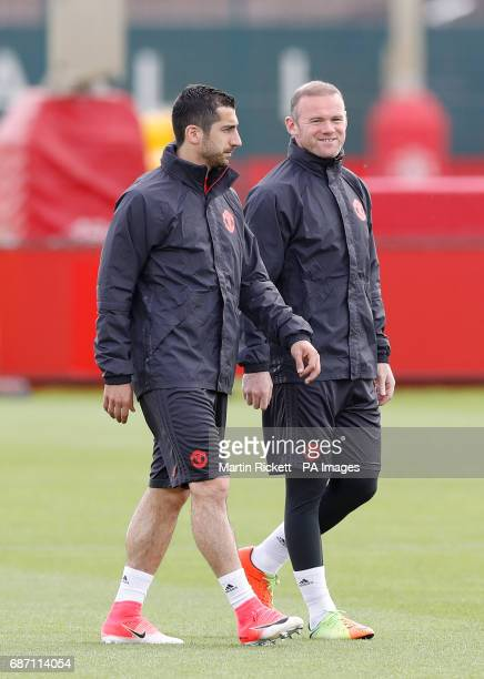 Manchester United's Henrikh Mkhitaryan and Wayne Rooney during the training session at the AON Training Complex in Carrington ahead of the Europa...