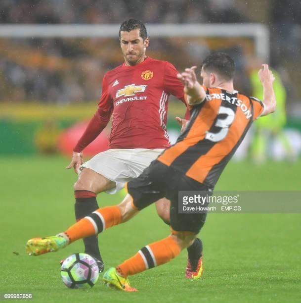 Manchester United's Henrikh Mkhitaryan battles with Hull City's Andrew Robertson