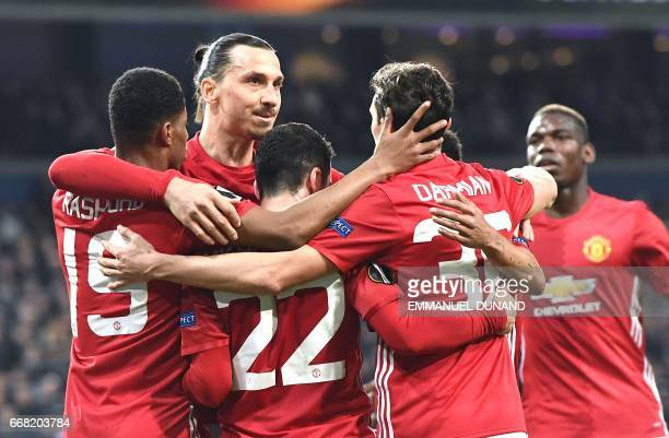 TOPSHOT Manchester United's Henrikh Mkhitaryan celebrates with teammates after scoring during the UEFA Europa League match between Anderlecht and...